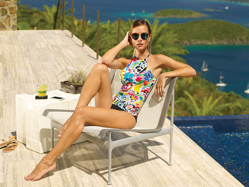 Graphic and bold — colors of the season encircle the halter top of a sheared-side tankini like an artist's rendering by Anne Cole Signature, shown with a black brief.