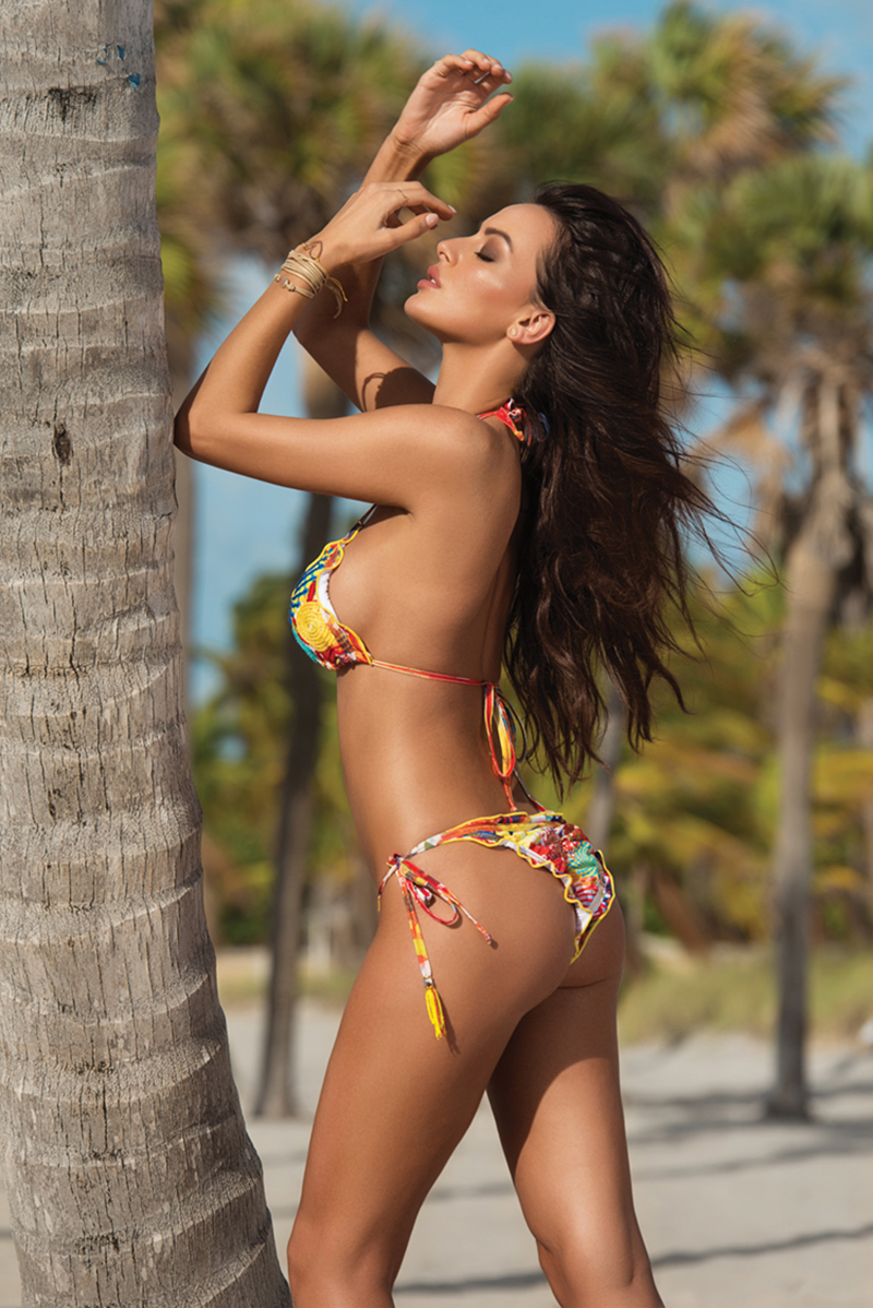 Ruffles and ruching add flirtatious detail to this tropical-flavored itsy bitsy bikini by Liliana Montoya.