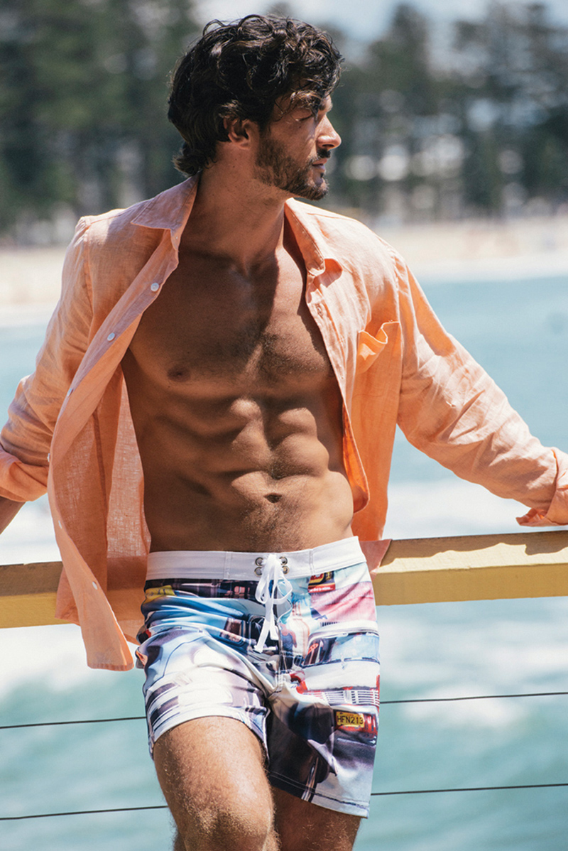 Muchacho brings style and sex appeal to men's swimwear. A colorful photo-print is accented with crisp white and is shown with an easy-care relaxed shirt in apricot. The drawstring tie allows for a perfect fit.